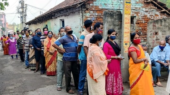Voters stand in long queues on polling day in West Bengal. The seventh phase of the state assembly elections will witness an intense battle across six constituencies in Dakshin Dinajpur, six in Malda, nine in Murshidabad, nine in Paschim Bardhaman, and four in Kolkata, amid the ongoing Covid-19 pandemic. (File Photo / Representational Image)