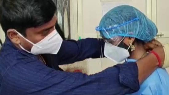 Instead of traditional clothes, the bride wore a PPE kit as the bridegroom had tested positive for COVID-19.(ANI)
