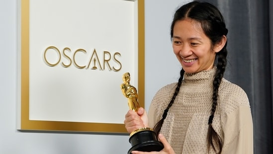 """Director/Producer Chloe Zhao, winner of the award for best picture for """"Nomadland,"""" poses at the press room of the Oscars, in the 93rd Academy Awards in Los Angeles, California. (Reuters)"""