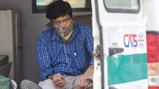 A Covid-19 patient waits in an ambulance outside the LNJP hospital, in New Delhi, Monday, April 26, 2021. (PTI)