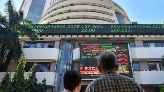 People watch the Sensex on a screen outside Bombay Stock Exchange (BSE) in Mumbai. (PTI File Photo)