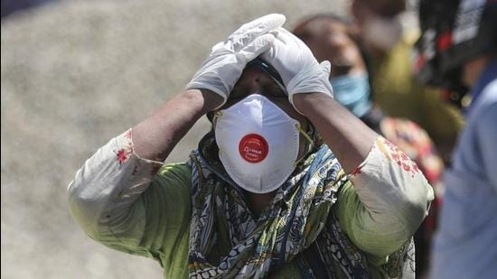 A relative of a Covid-19 victim at a crematorium in Jammu. (File photo)