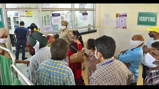 Local residents stand in queues outside a vaccination counter at the civil surgeon's office in Ludhiana on Tuesday. (Gurpreet Singh/HT)