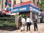 HDFC Bank's <span class='webrupee'>₹</span>5,456 crore retail loan recast tipped the scales. Axis Bank restructured <span class='webrupee'>₹</span>504 crore of retail loans and <span class='webrupee'>₹</span>341 crore of corporate loans.(File photo)