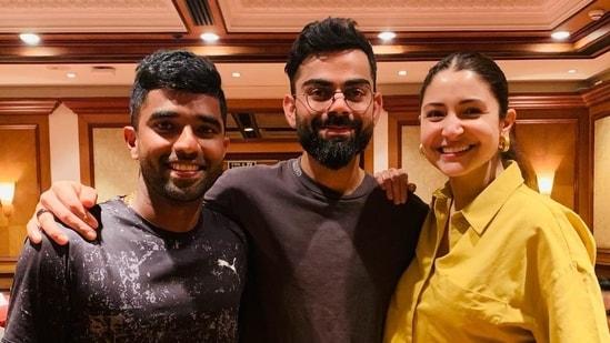 Anushka Sharma and Virat Kohli pose with Royal Challengers Bangalore batsman Sachin Baby.