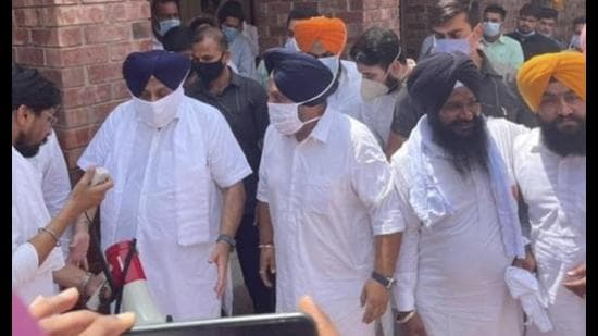 Shiromani Akali Dal president Sukhbir Singh Badal with others at his residence in Muktsar district on Wednesday.