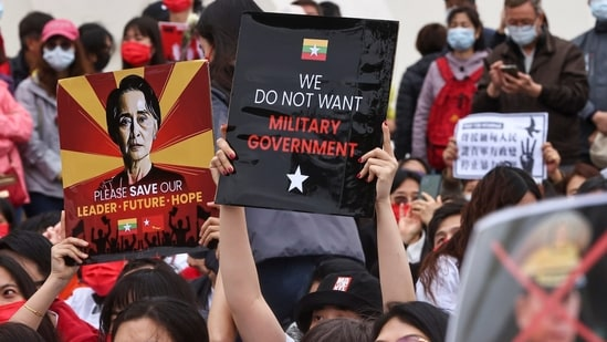 People hold placards as they gather to denounce the Myanmar military coup. REUTERS/Ann Wang
