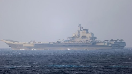 Chinese aircraft carrier Liaoning sails through the Miyako Strait near Okinawa on its way to the Pacific. (REUTERS)