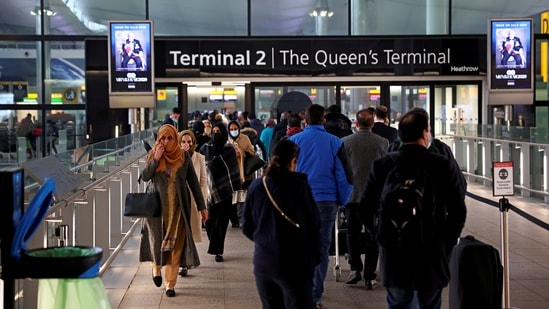 People queue to enter terminal 2, as tighter rules for international travellers start, at Heathrow Airport, amid Covid-19 pandemic.(Reuters)