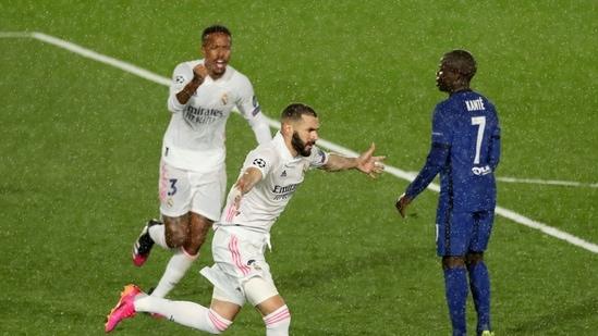 Real Madrid's Karim Benzema celebrates scoring their first goal with teammates (REUTERS)
