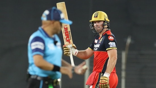 AB de Villiers of Royal Challengers Bangalore raises his bat after scoring a fifty during the match between the Royal Challengers Bangalore and Delhi Capitals at the Narendra Modi Stadium in Ahmedabad on Tuesday.(ANI Photo/IPL Twitter)