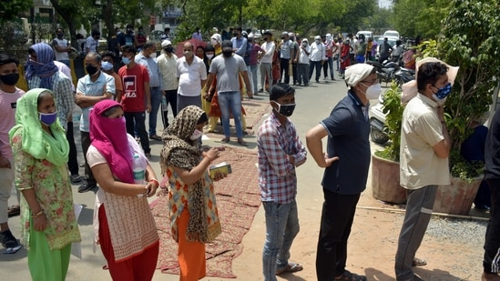 People wait to give swab samples for Covid-19 test at Gyan Khand 4 in Indirapuram, Ghaziabad on Tuesday.(Sakib Ali/HT Photo )