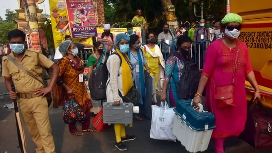 Polling officials carrying EVMs and other polling materials on the eve of the 8th phase of the West Bengal Assembly election, in Kolkata on Wednesday. (ANI Photo)