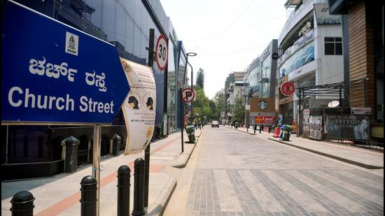 A deserted view of Church Street on the first day of curfew imposed amid a surge in Covid-19 cases in Bengaluru on Wednesday. (ANI PHOTO.)
