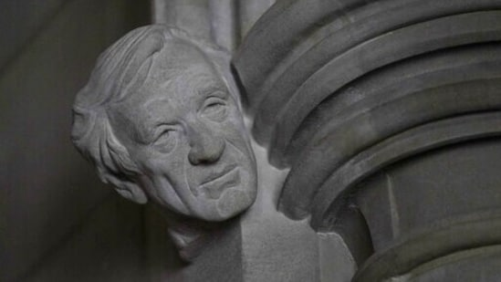 """A limestone head of Holocaust survivor and Nobel Peace Prize winning author Elie Wiesel, carved by Sean Callahan from a clay sculpture by artist Chas Fagan, is almost complete in the Human Rights Porch of the Washington National Cathedral, Friday, April 16, 2021. Wiesel, who died in 2016, was the author of 57 books including """"Night,"""" which is based on his experiences as a Jewish prisoner in the Auschwitz and Buchenwald concentration camps. He became an outspoken advocate for human rights causes around the world, helped found the United States Holocaust Memorial Museum and was awarded the Nobel Peace Prize in 1986. (AP)"""