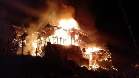 Houses on fire in Fanail village of Kotkhai in Shimla district on Wednesday. (HT Photo)