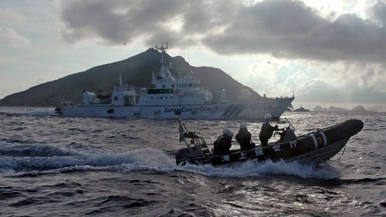 The Chinese report also included some photos of the island and islets taken from survey vessels sailing close to the site. In picture - A Japanese Coast Guard boat sails near the group of disputed islands called Senkaku by Japan and Diaoyu by China.(AP File Photo)