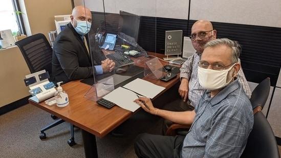 Arun Kankani, President of Sewa International USA, and Yagnesh Patel, Compliance Manager of Sewa International USA, at the bank.(Twitter / @sewausa)