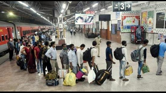 Migrants from Maharashtra wait in a queue for Covid-19 test at Patna railway station. (File photo)