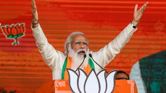 Prime Minister Narendra Modi addresses a public rally ahead of West Bengal state elections in Kolkata, India.(AP)