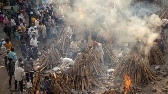 People cremate their relatives, who died due to the coronavirus disease (Covid-19), at a crematorium ground in New Delhi, India, April 28, 2021. (REUTERS)