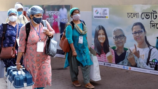 Polling officials carrying EVMs and other polling materials on the eve of the 8th phase of the West Bengal Assembly election on Wednesday. (ANI Photo)