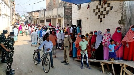 Voters stand outside a polling booth to cast their vote during the 8th and final phase of the West Bengal Assembly election.(ANI)