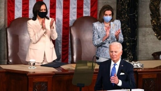 President Joe Biden addresses a joint session of Congress Wednesday, April 28, 2021, in the House Chamber at the U.S. Capitol in Washington, as Vice President Kamala Harris, left, and House Speaker Nancy Pelosi of Calif., look on. (AP)