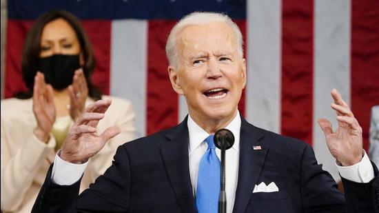 US Vice-President Kamala Harris applauds as President Joe Biden addresses a joint session of Congress in Washington, DC. (AP)