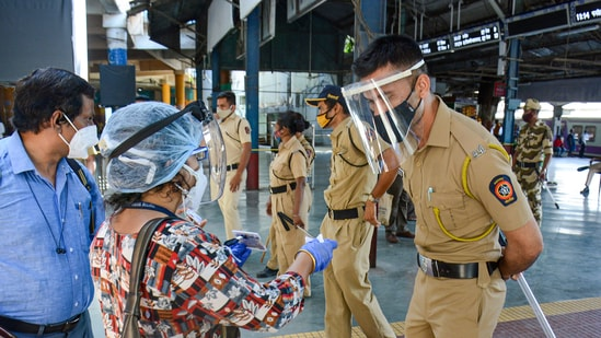 Police checking ID cards as strict lockdown is imposed in Maharashtra from today, in Thane. (PTI file photo)