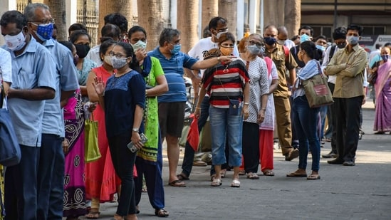 People stand in a queue to receive a dose of Covid-19 vaccine at Nair Hospital in Mumbai.(PTI Photo)