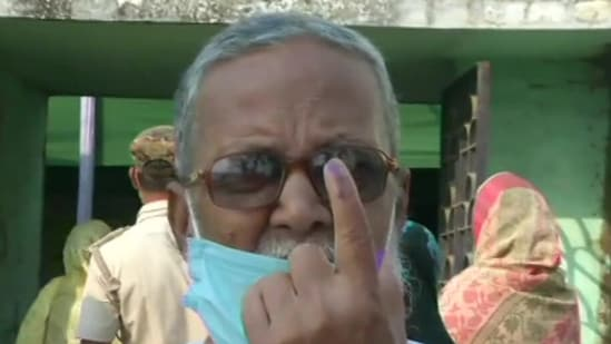 A voter shows his inked finger after voting in the eighth and final phase of the West Bengal assembly elections, at a polling booth in Murshidabad (ANI)