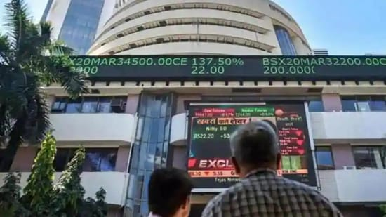 People watch the Sensex on a screen outside Bombay Stock Exchange (BSE) in Mumbai.