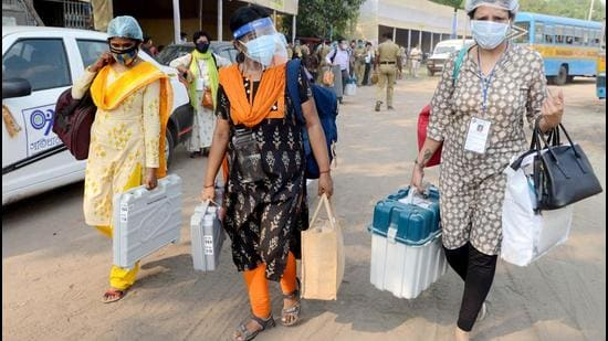 Polling officials carrying EVMs and other polling materials on the eve of the eighth phase of the West Bengal assembly election, at Netaji Indoor Stadium in Kolkata on Wednesday, April 28. (ANI)