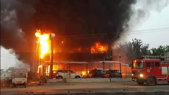 The fire that broke out at a car showroom on Mansa road in Bathinda on Thursday morning. It took the fire tenders three hours to control the blaze. (Sanjeev Kumar/HT)
