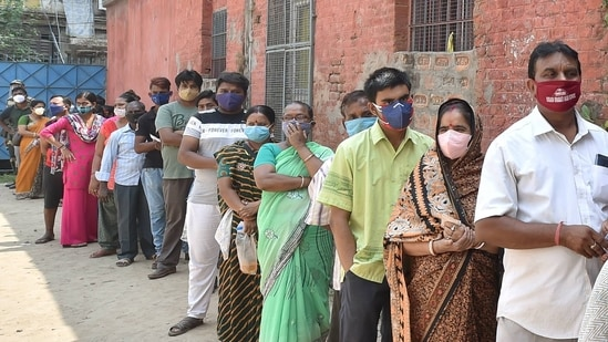 Voters stand in line during polling for the West Bengal assembly elections in Kolkata (PTI).