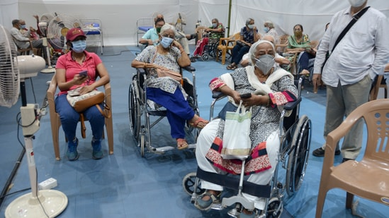 Beneficiaries above the age of 45 years waiting to get vaccinated at the NESCO Jumbo Covid-19 Vaccination Centre in Mumbai on Thursday.(Vijay Bate/HT Photo)