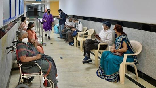 People await to register themselves to be inoculated with the Covid-19 coronavirus vaccine at MS Ramaiah Hospital in Bengaluru on March 1. (File photo)