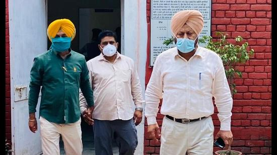 The accused (centre) in VB custody.