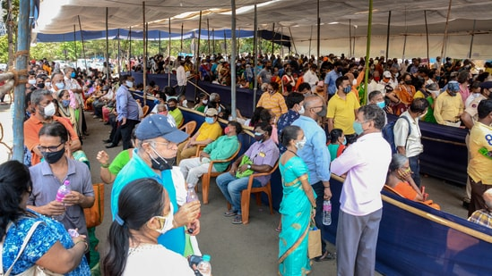 People waiting for their vaccine doses at a centre in Mumbai. (PTI)