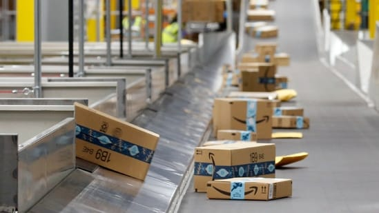 Amazon's total net sales from the quarter grew 44 per cent from the year-ago period to 108.5 billion dollars. In picture - Packages move along a conveyor at an Amazon warehouse facility.(AP)