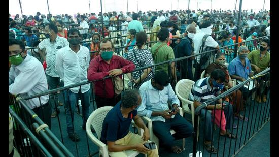 People wait for their dose of Covid-19 vaccine at BKC Jumbo Covid-19 Vaccination Centre, in Mumbai on April 27. (ANI)