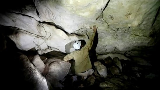 Archeologist Sergio Grosjean explores a cave with hand prints, reportedly 1,200 years old, in Merida, Mexico.(via REUTERS)