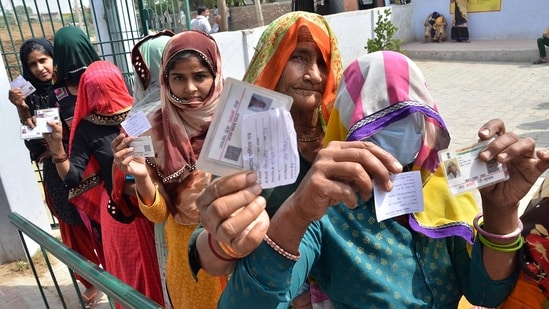 Voters standing in a queue showing their voter IDs to cast vote in Uttar Pradesh Panchayat Election, in Mathura on Thursday. (ANI Photo)