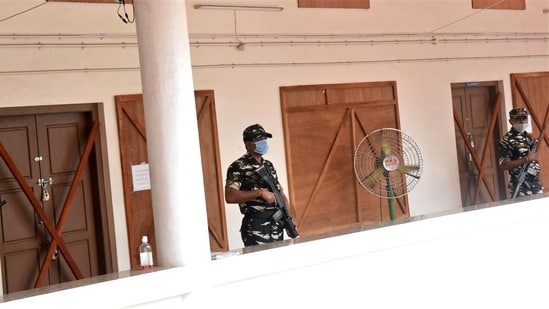 Security personnel stand guard outside a strong room ahead of counting of votes of the Kerala Assembly election, in Ernakulam district on Saturday. (ANI Photo)