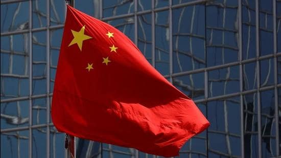 A file photo of China's national flag is seen fluttering in Beijing. (REUTERS)