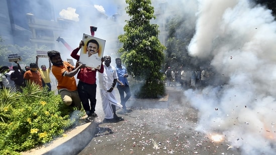 DMK workers celebrate the party's win in the Tamil Nadu assembly poll results, at the party headquarters in Chennai on Sunday. (PTI Photo/R Senthil Kumar)(PTI)
