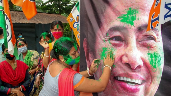 Trinamool Congress supporters celebrate their party's victory in the assembly elections, in South Dinajpur district on Sunday. (PTI Photo)(PTI)