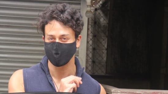 Tiger Shroff was seen in Santacruz on Sunday with half his face covered behind a black mask.(Varinder Chawla)