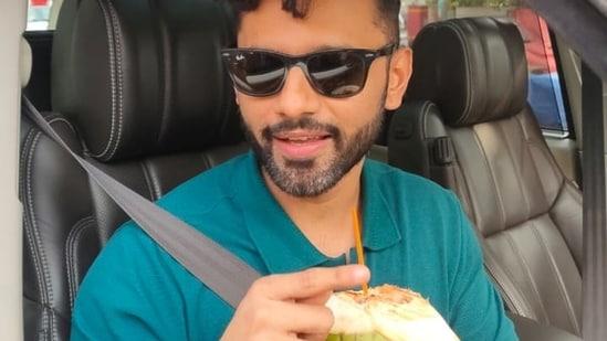 Rahul Vaidya enjoys coconut water on a hot summer day in Mumbai.(Varinder Chawla)